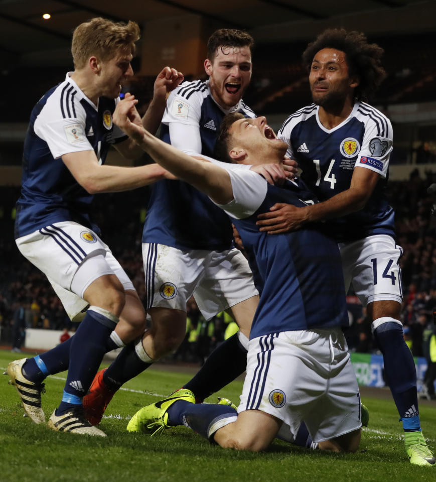 Britain Football Soccer - Scotland v Slovenia - 2018 World Cup Qualifying European Zone - Group F - Hampden Park, Glasgow, Scotland - 26/3/17 Scotland's Chris Martin celebrates scoring their first goal with team mates Reuters / Russell Cheyne Livepic EDITORIAL USE ONLY.