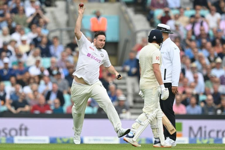 Pitch invader: YouTuber Daniel Jarvis, known as 'Jarvo 69' pretends to bowl as he delays play in the fourth Test between England and India at the Oval (AFP/DANIEL LEAL-OLIVAS)