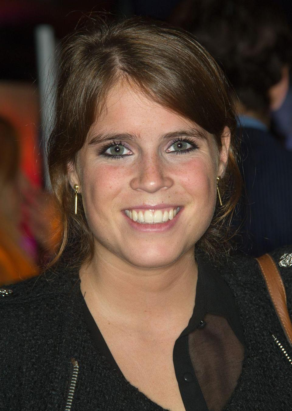 <p>Princess Eugenie opted for simple gold earrings at a party in October 2012. </p>