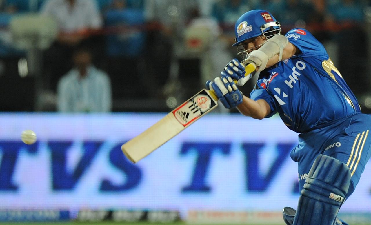 Mumbai Indians batsman Sachin Tendulkar plays a shot during the IPL Twenty20 cricket match between Pune Warriors and Mumbai Indians at The Subroto Roy Sahara Stadium in Pune on May 3, 2012.  RESTRICTED TO EDITORIAL USE. MOBILE USE WITHIN NEWS PACKAGE    AFP PHOTO/Indranil MUKHERJEE        (Photo credit should read INDRANIL MUKHERJEE/AFP/GettyImages)