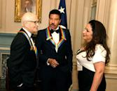2017 Kennedy Center Honorees singer Lionel Ritchie (C), TV writer Norman Lear (L) and Cuban-American singer Gloria Estefan chat among themselves at the conclusion of a gala dinner at the U.S. State Department, in Washington, U.S., December 2, 2017. REUTERS/Mike Theiler