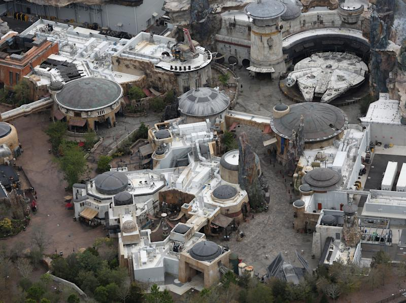 The Millennium Falcon spaceship sits amid empty streets at Empty Star Wars: Galaxy's Edge inside Disney's Hollywood Studios theme park after it closed in an effort to combat the spread of coronavirus disease (COVID-19), in an aerial view in Orlando, Florida, U.S. March 16, 2020. REUTERS/Gregg Newton