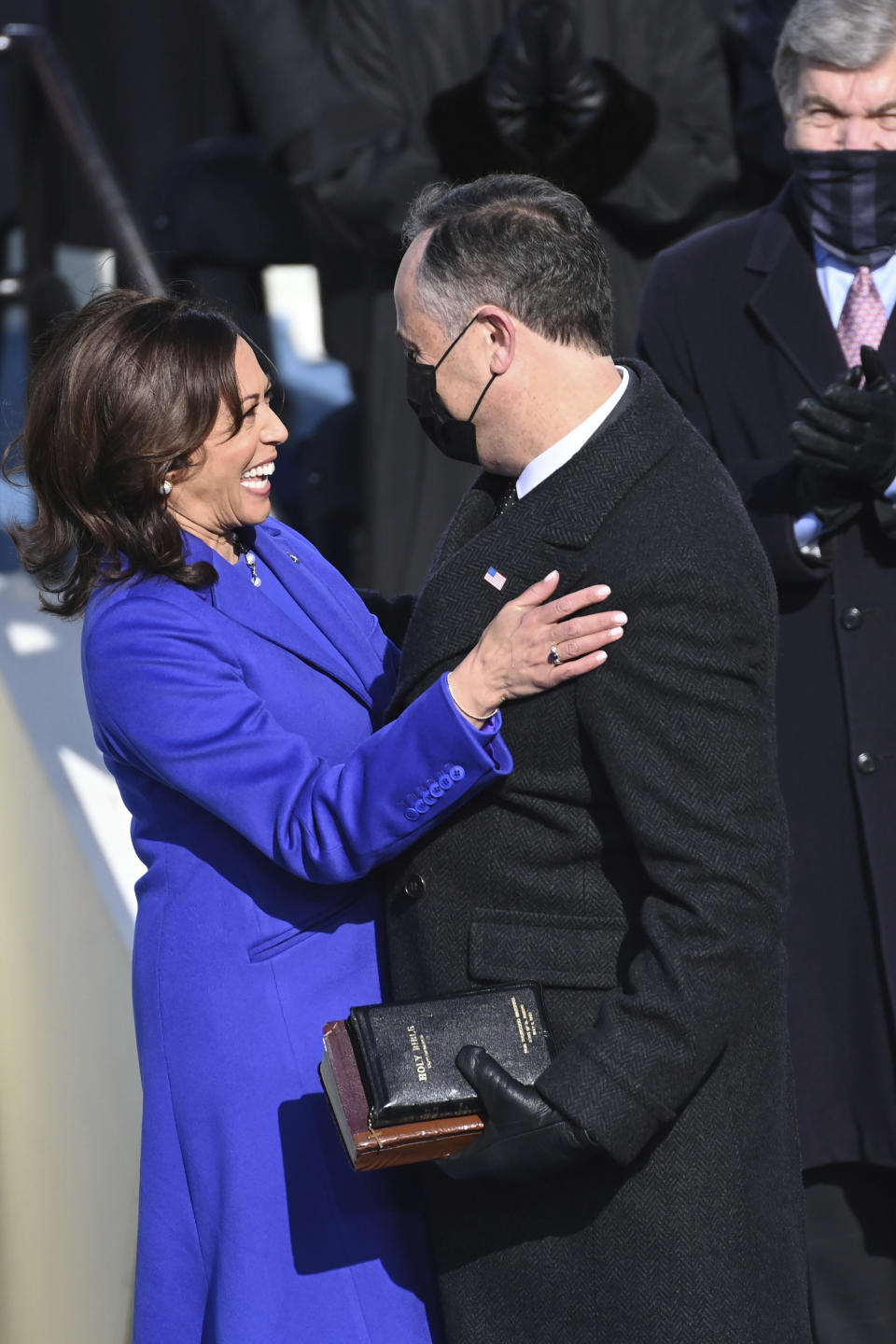 Vice President Kamala Harris is embraced by her husband Doug Emhoff after she was sworn into office during the 59th Presidential Inauguration at the U.S. Capitol in Washington, Wednesday, Jan. 20, 2021.(Saul Loeb/Pool Photo via AP)