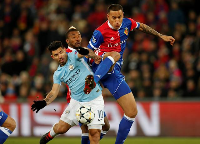 Soccer Football - Champions League - Basel vs Manchester City - St. Jakob-Park, Basel, Switzerland - February 13, 2018 Manchester City's Sergio Aguero in action with Basel's Leo Lacroix Action Images via Reuters/Andrew Boyers