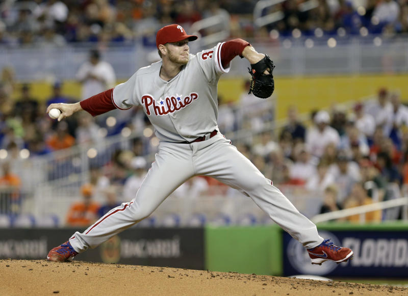 Philadelphia Phillies' Roy Halladay pitches to the Miami Marlins during the first inning of a baseball game in Miami, Sunday, April 14, 2013. (AP Photo/Alan Diaz6