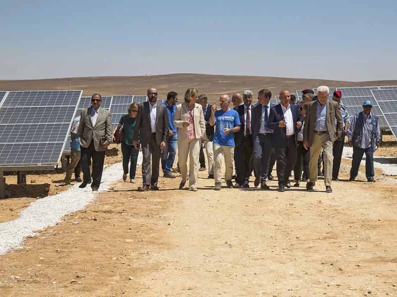 Officials from the IKEA Foundation, and the U.N. refugee agency tour a newly inaugurated solar energy plant, that will provide about 20,000 Syrian refugees with electricity, in the Azraq Refugee Camp, Jordan: Elena Boffetta/AP Photo