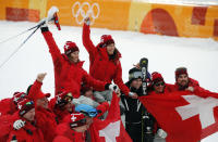 <p>Switzerland's gold and silver medalists Michelle Gisin and Wendy Holdener are hoisted aloft by team members after the Women's Combined Slalom at the PyeongChang 2018 Winter Olympics on Feb. 22, 2018.<br> (AP Photo/Christophe Ena) </p>