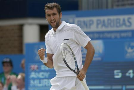 Croatia's Marin Cilic reacts after winning the first set during his men's singles final tennis match against Britain's Andy Murray at the Queen's Club Championships in west London June 16, 2013. REUTERS/Eddie Keogh