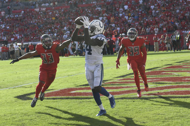 Indianapolis Colts wide receiver Zach Pascal (14) catches a pass for a score as Tampa Bay Buccaneers cornerback Carlton Davis (33) and strong safety Andrew Adams (39) defend during the second half of an NFL football game Sunday, Dec. 8, 2019, in Tampa, Fla. (AP Photo/Jason Behnken)