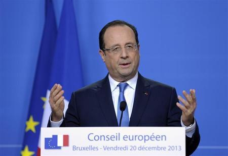 France's President Francois Hollande addresses a news conference during a European Union leaders summit in Brussels