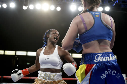 Claressa Shields, left, swings at Belgium's Femke Hermans, during their WBC/IBF/WBA middleweight title boxing match, Saturday, Dec. 8, 2018, in Carson, Calif. (AP Photo/Chris Carlson)