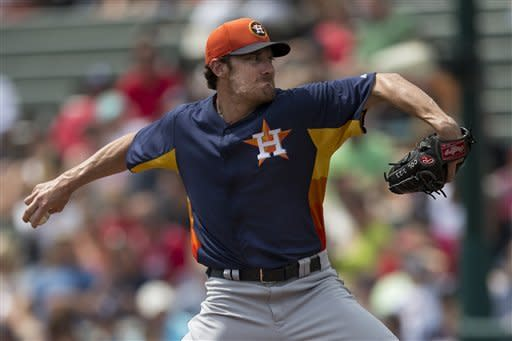 Houston Astros pitcher Philip Humber delivers a pitch during the first inning of an exhibition spring training baseball game against the Atlanta Braves on Saturday, March 23, 2013, in Kissimmee, Fla. (AP Photo/Evan Vucci)