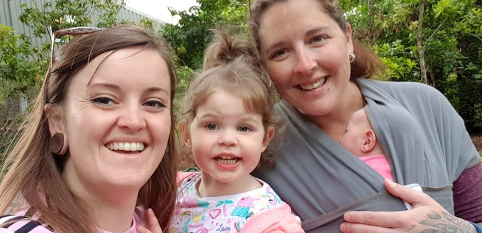 Jade Spargo (left) pictured with her partner Sabrina and their two daughters, Willow, 2, (second left) and Tilda. [Photo: SWNS]