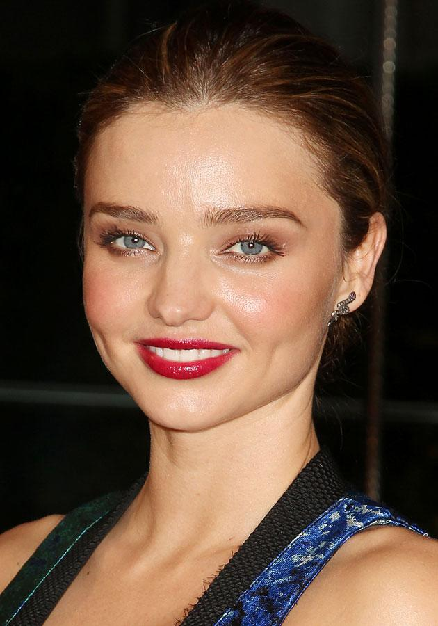 Miranda Kerr looked amazing with a dark red pout. [Rex]