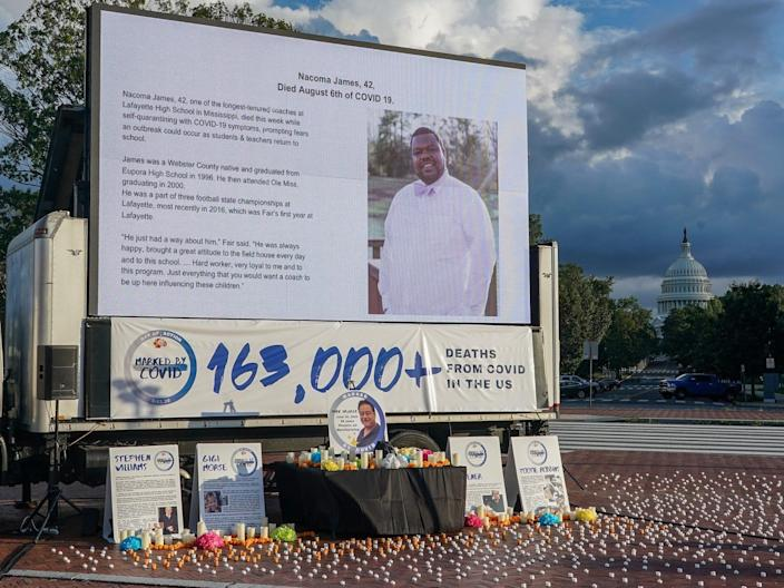 """A slide memorializing Nacoma James on an altar built by #MarkedbyCovid in Washington, DC, to honor people who have died from COVID-19. <p class=""""copyright"""">Jemal Countess/Getty Images for #MarkedbyCovid</p>"""
