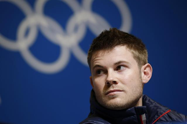 U.S. speedskater Joey Mantia listens to a reporter's question during a 2014 Winter Olympics news conference, Thursday, Feb. 6, 2014, in Sochi, Russia. (AP Photo/Patrick Semansky)