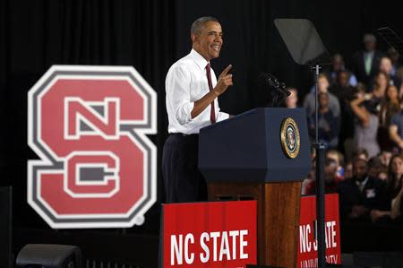 U.S. President Barack Obama speaks about jobs and the economy at North Carolina State University in Raleigh January 15, 2014. REUTERS/Kevin Lamarque