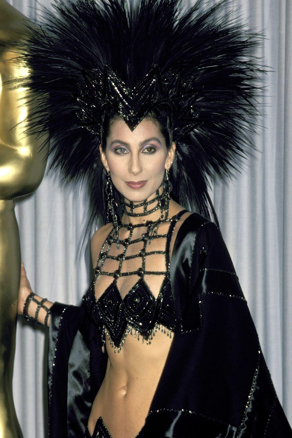 <p>Since Cher's abs can't be an accessory of their own, we'll have to settle for her feathered headpieces. The star rocked them from the stage to the red carpet, and even wore a black sparkly one at the 1986 Oscars. </p>
