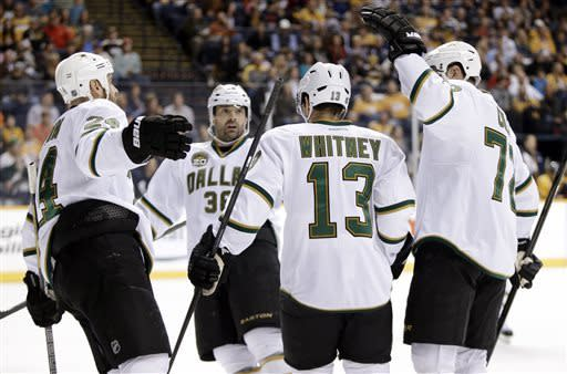 Dallas Stars left wing Ray Whitney (13) is congratulated by teammate Eric Nystrom (24), Vernon Fiddler (38) and Erik Cole (72) after scoring against the Nashville Predators in the first period of an NHL hockey game on Friday, April 12, 2013, in Nashville, Tenn. (AP Photo/Mark Humphrey)