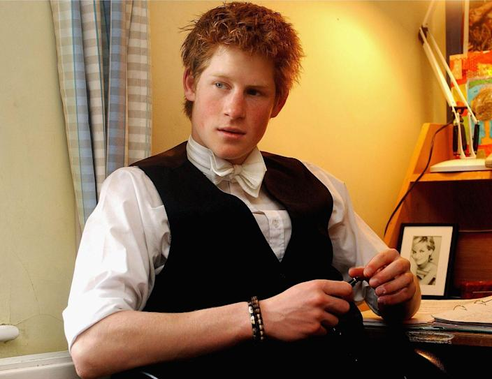 """<p>Harry hangs out in his dorm room, which includes a photo of Princess Diana, at Eton College during a portrait series that was taken ahead of his graduation. In 2015, <a href=""""https://www.telegraph.co.uk/news/uknews/prince-harry/12025764/Prince-Harry-I-hated-Eton-and-wanted-to-be-bad-boy.html"""" rel=""""nofollow noopener"""" target=""""_blank"""" data-ylk=""""slk:Harry revealed"""" class=""""link rapid-noclick-resp"""">Harry revealed</a> that he """"didn't enjoy school at all"""" and simply """"wanted to be the bad boy.""""</p>"""