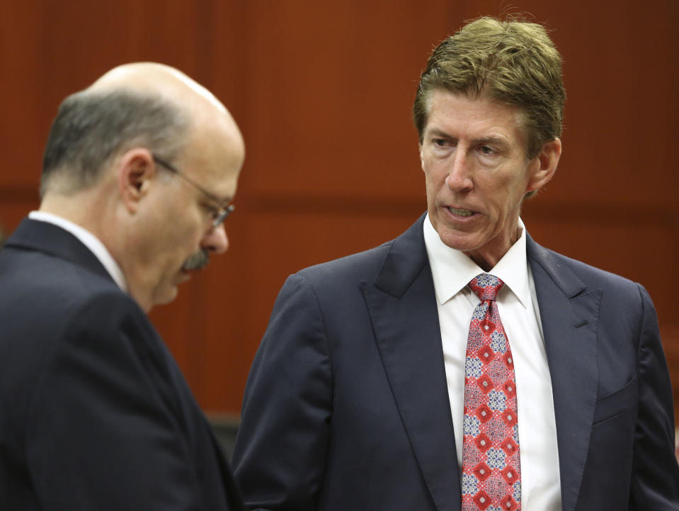 Defense attorney Mark O'Mara, right, speaks with assistant state attorney Bernie de la Rionda during George Zimmerman's trial in Seminole circuit court in Sanford, Fla. Wednesday, July 10, 2013. Zimmerman has been charged with second-degree murder for the 2012 shooting death of Trayvon Martin. (AP Photo/Orlando Sentinel, Gary W. Green, Pool)