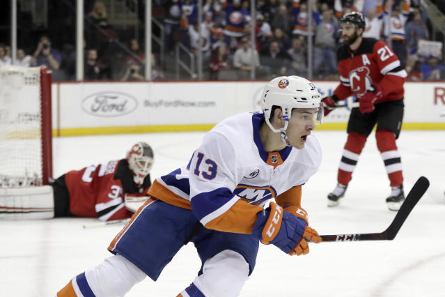 New York Islanders center Mathew Barzal (13) celebrates his first-period goal against the New Jersey Devils during an NHL hockey game Thursday, Feb. 7, 2019, in Newark, N.J. (AP Photo/Julio Cortez)