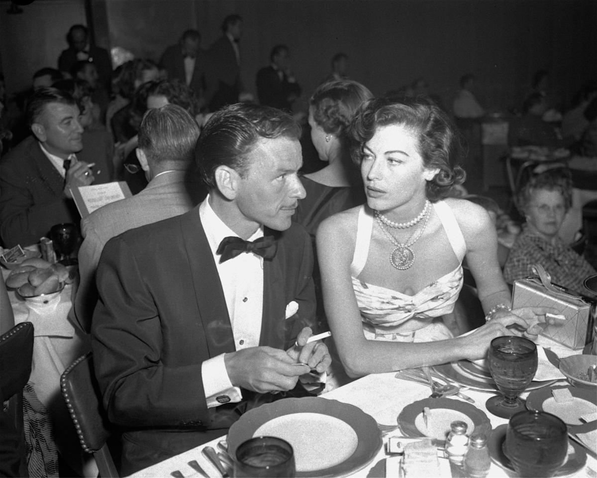 FILE - In this Aug. 19, 1951 file photo, singer Frank Sinatra and Ava Gardner hold cigarettes as they dine together at the Riverside Hotel in Reno, Nev. On Jan. 11, 1964, U.S. Surgeon General Luther Terry released an emphatic and authoritative report that said smoking causes illness and death - and the government should do something about it. (AP Photo)