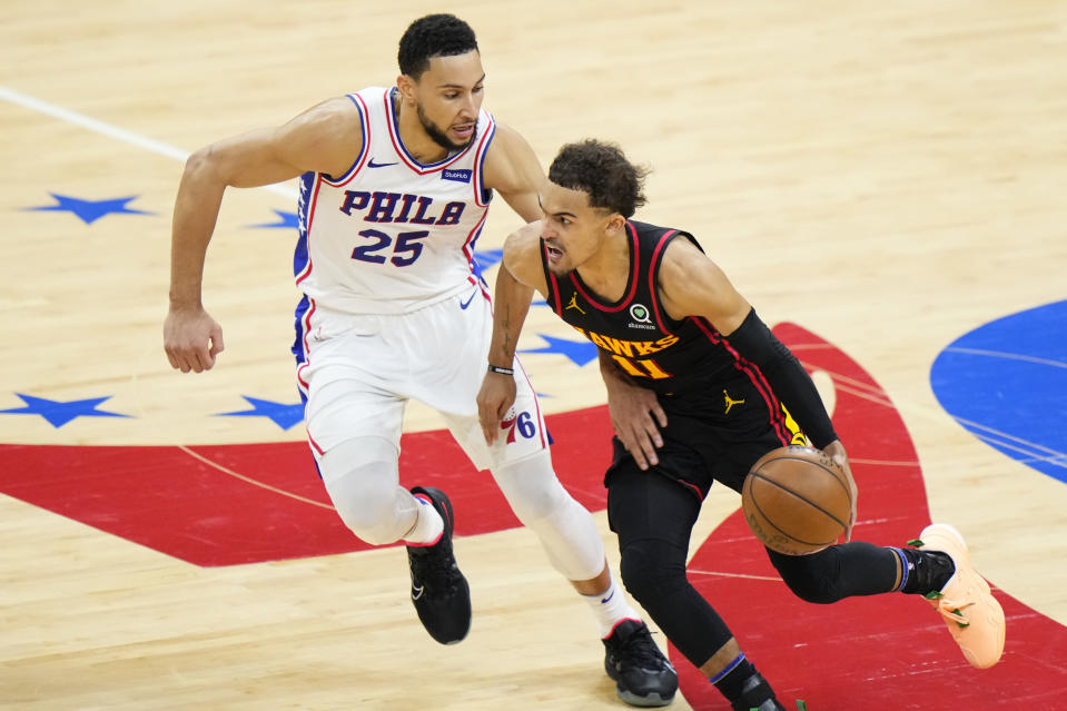 Atlanta Hawks' Trae Young, right, tries to get past Philadelphia 76ers' Ben Simmons during the second half of Game 7 in a second-round NBA basketball playoff series, Sunday, June 20, 2021, in Philadelphia. (AP Photo/Matt Slocum)