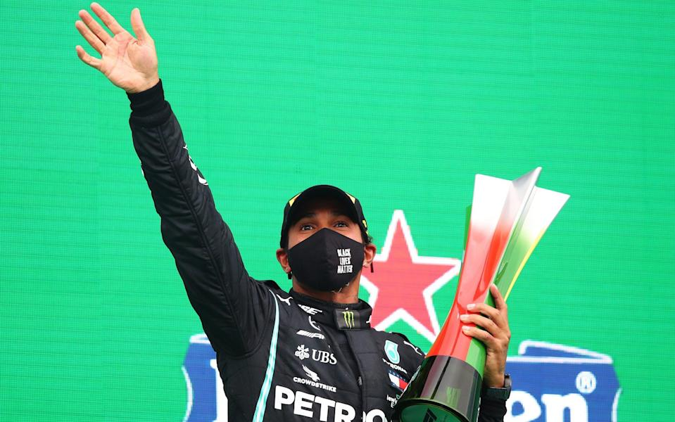 Race winner Lewis Hamilton of Great Britain and Mercedes GP celebrates his record breaking 92nd race win on the podium during the F1 Grand Prix of Portugal at Autodromo Internacional do Algarve on October 25, 2020 in Portimao, Portugal - Getty Images Europe/Joe Portlock