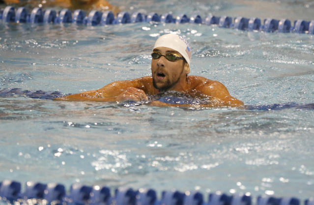 Michael Phelps catches his breath after winning the 100-meter butterfly in the at the Arena Grand Prix swim meet in Charlotte, N.C., Friday, May 16, 2014. Phelps won the race with a time of 52.13. (AP Photo/Nell Redmond)