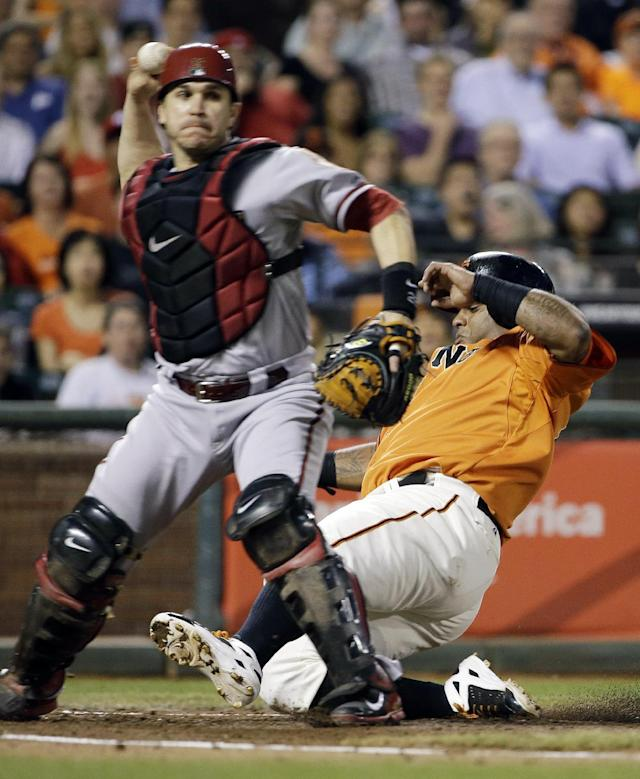 San Francisco Giants' Pablo Sandoval, right, is out at home plate as Arizona Diamondbacks catcher Miguel Montero, left, throws out the Giants' Yusmeiro Petit for a double play in the second inning of their baseball game, Friday, Sept. 6, 2013, in San Francisco. (AP Photo/Eric Risberg)