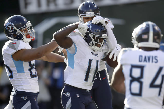 Tennessee Titans wide receiver A.J. Brown (11) is congratulated by teammates after scoring against the Oakland Raiders during the first half of an NFL football game in Oakland, Calif., Sunday, Dec. 8, 2019. (AP Photo/Ben Margot)