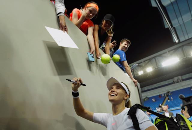FILE PHOTO: Tennis - Australian Open - Melbourne Park, Melbourne, Australia - 16/1/17 Canada's Eugenie Bouchard signs autographs after winning her Women's singles first round match against Louisa Chirico of the U.S. REUTERS/Jason Reed/File Photo
