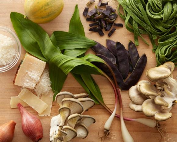 Various food ingredients on a wood counter.