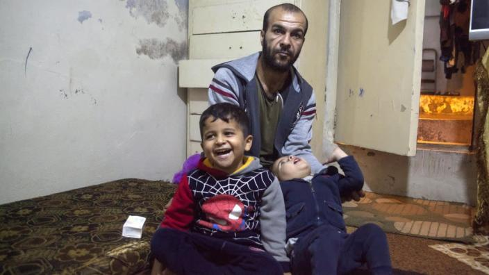 "<div class=""inline-image__caption""><p>Ra'ad Hariri and his two sons sit in their one room apartment they have rented since being evicted from their house in Karantina following renovations after the Port explosion.</p></div> <div class=""inline-image__credit"">Tessa Fox for The Daily Beast</div>"
