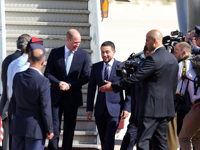 Prince William (L) is greeted at Amman's Marka military airport by Jordanian Crown Prince Hussein bin Abdullah (AFP/Getty Images)