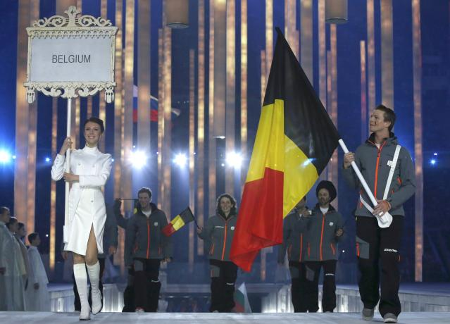 Belgium's flag-bearer Denis Colle (R), leads his country's contingent during the opening ceremony of the 2014 Paralympic Winter Games in Sochi, March 7, 2014. REUTERS/Alexander Demianchuk (RUSSIA - Tags: OLYMPICS SPORT)