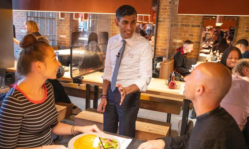 Rishi Sunak staged a photocall at a Wagamama restaurant where he was seen serving customers but not wearing a face mask (Simon Walker/HM Treasury)