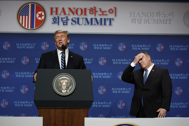 President Donald Trump speaks as Sec. of State Mike Pompeo looks on during a news conference after the summit on Feb. 28, 2019, in Hanoi Vietnam.