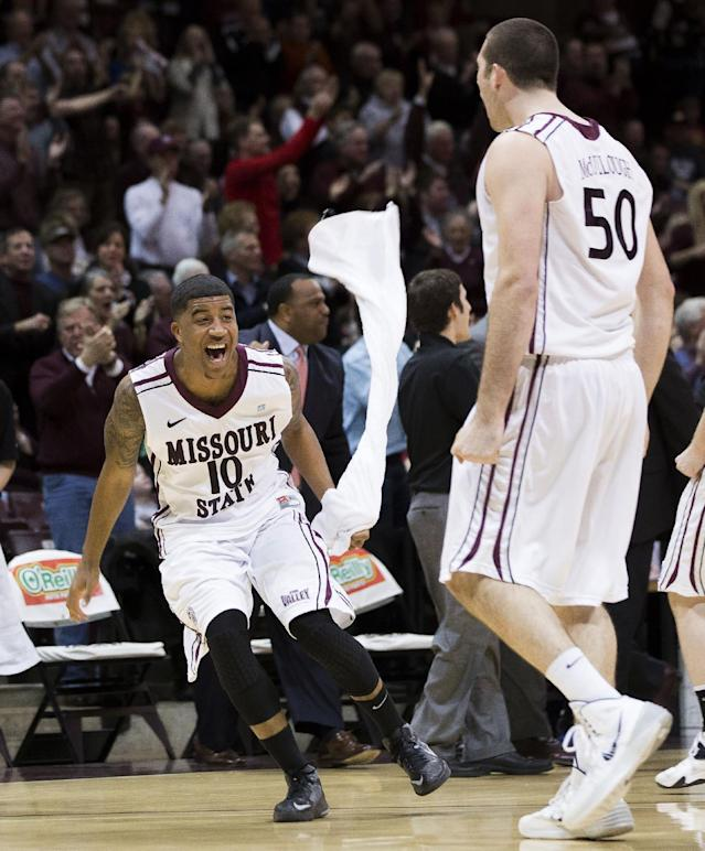 Missouri State guard Ron Mvouika (10) celebrates on the court after a timeout was called during the first half of an NCAA college basketball game against Wichita State on Saturday, Jan. 11, 2014, in Springfield, Mo. (AP Photo/David Welker)