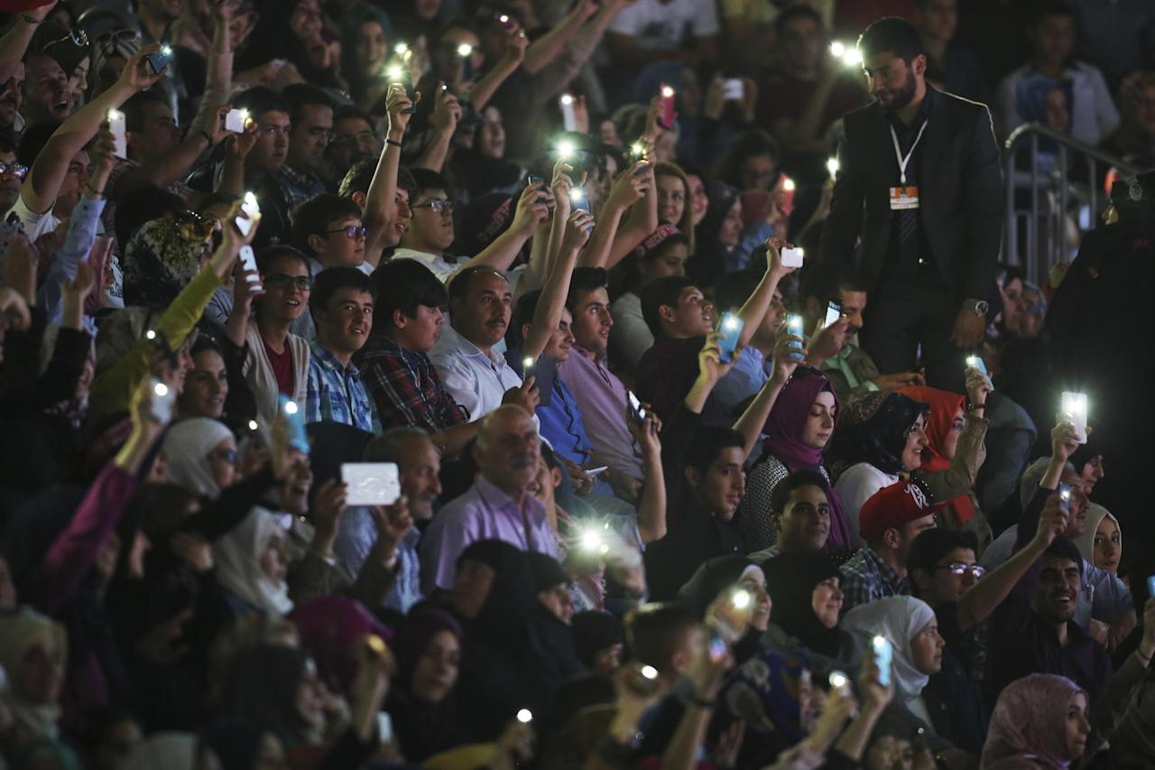 "People hold their mobile phones as they wait for Turkey's President Recep Tayyip Erdogan during an international students meeting in Istanbul, Saturday, May 16, 2015. Erdogan has criticized Egypt for sentencing ousted President Mohammed Morsi to death, saying the country was returning to the ""old Egypt"" by rolling back democracy. Turkey's government strongly supports the Muslim Brotherhood. On Saturday, an Egyptian court sentenced Morsi to death over his part in a mass prison break that took place during the 2011 uprising that toppled Egypt's long-time leader Hosni Mubarak. (AP Photo/Emrah Gurel)"