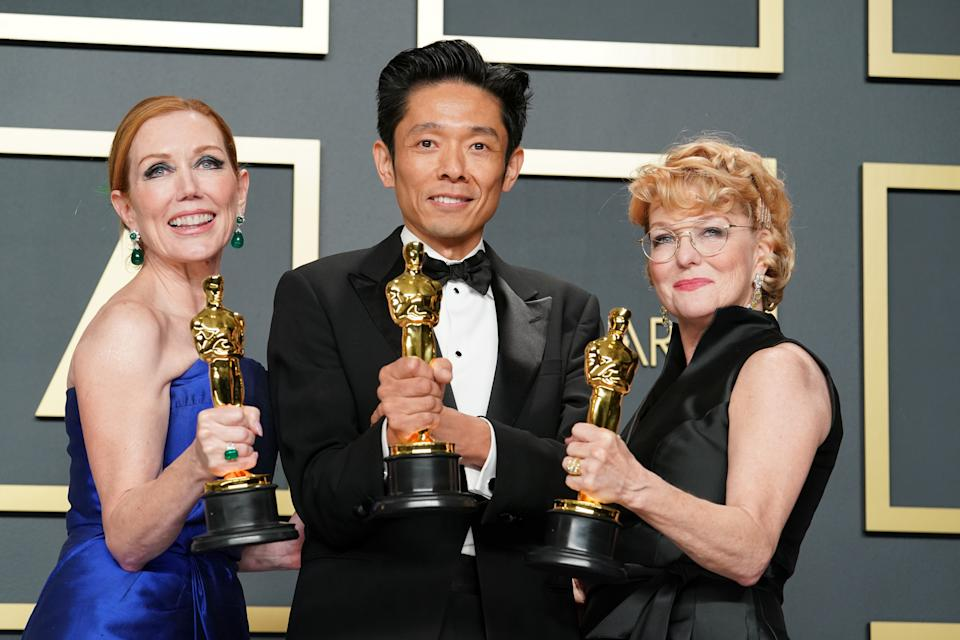 "Anne Morgan, Kazu Hiro and Vivian Baker, winners of the Makeup and Hairstyling award for ""Bombshell"" at the 92nd Annual Academy Awards on February 09, 2020. (Photo by Rachel Luna/Getty Images)"
