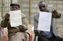 Detentions: Community leaders hold lists of people they say have been incarcerated in Nekemte (AFP Photo/SOLAN KOLLI)