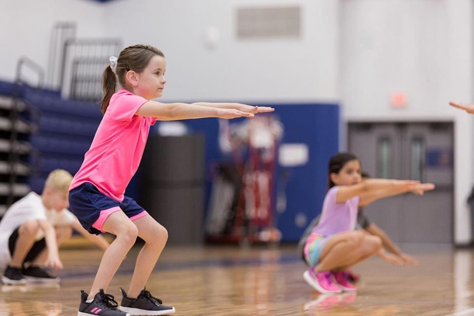 """<p>Oldham notes that <strong>squats help kids build endurance, strength, and even self-confidence</strong>. She likes to play a game called Hot Seat Squats. """"Place a stool or ottoman behind them while they squat, let their bum — or biscuits — graze the seat of it, then quickly stand. We call these Hot Seat Squats because you don't want your biscuits to get burned! You simply toast them. Most kids find them super fun because almost all kids are capable of successfully executing this exercise.""""</p>"""
