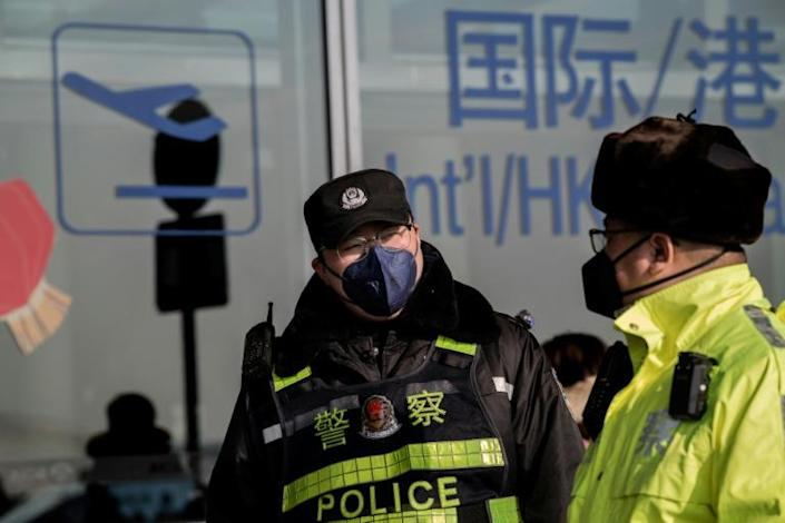 China's health commission announced measures to contain the disease, including sterilisation and ventilation at airports (AFP Photo/NICOLAS ASFOURI)