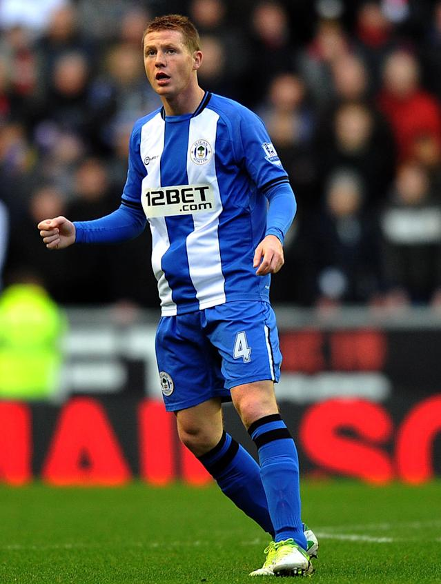 "Wigan Athletic's Scottish-born Irish midfielder James McCarthy in action during the English Premier League football match between Wigan Athletic and Manchester United at The DW Stadium in Wigan, north-west England on January 1, 2013. AFP PHOTO/PAUL ELLIS RESTRICTED TO EDITORIAL USE. No use with unauthorized audio, video, data, fixture lists, club/league logos or ""live"" services. Online in-match use limited to 45 images, no video emulation. No use in betting, games or single club/league/player publicationsPAUL ELLIS/AFP/Getty Images"