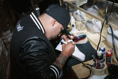 Artist Kickstradomis personalizing kicks live in Charlotte with eBay. Proceeds from his personal collection will support charity Project Fit.