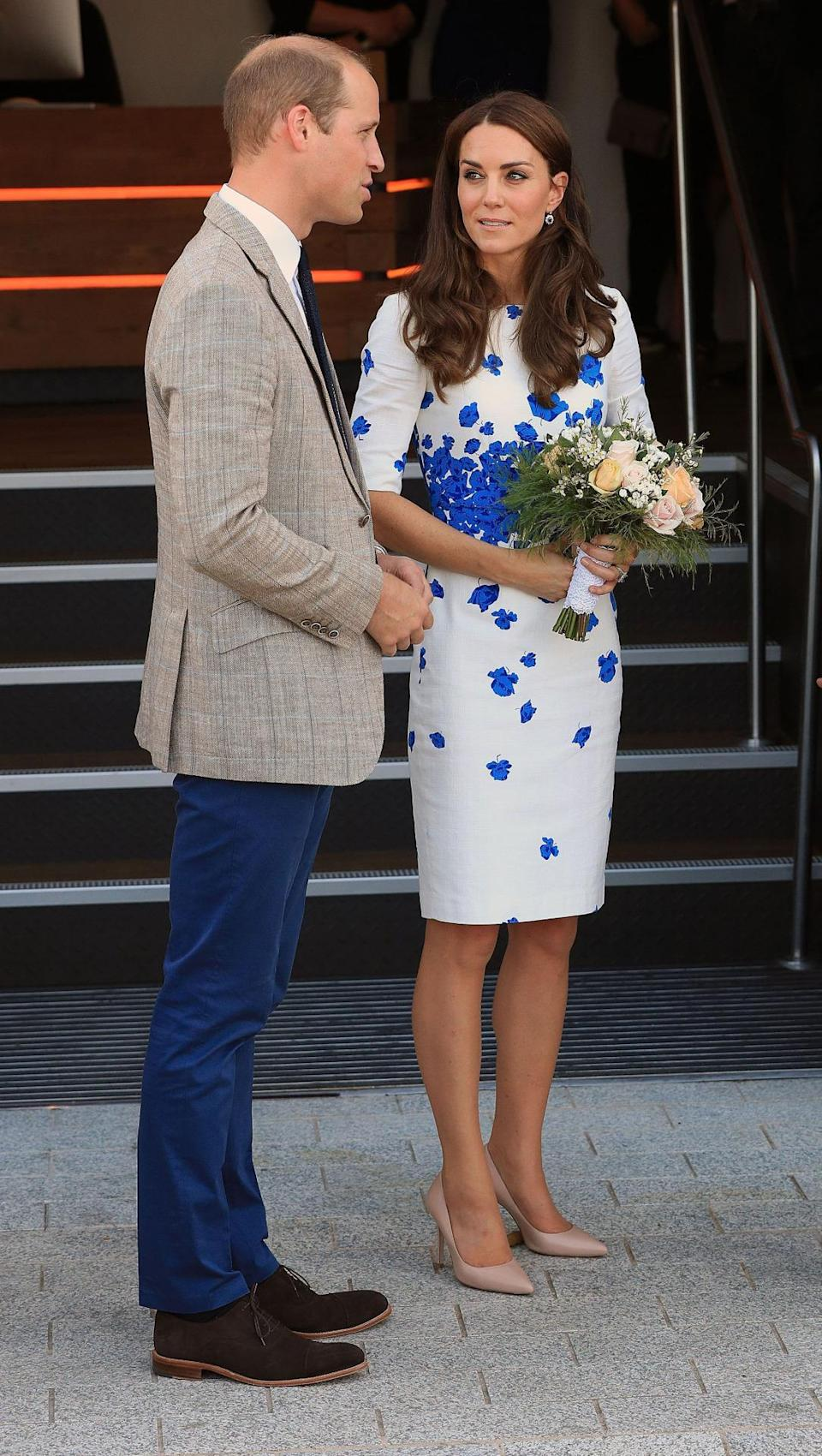 <p>For a tour of Luton's charities and hospices, Kate donned an old L.K. Bennett favourite: a simple white dress finished with a regal blue poppy print. Nude heels complemented the look perfectly.</p><p><i>[Photo: PA]</i></p>