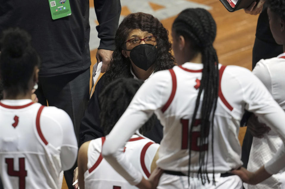 Rutgers head coach C. Vivian Stringer talks to her team during a timeout in the first half of a college basketball game against BYU in the first round of the women's NCAA tournament at the University Events Center in San Marcos, Texas, Monday, March 22, 2021. (AP Photo/Chuck Burton)