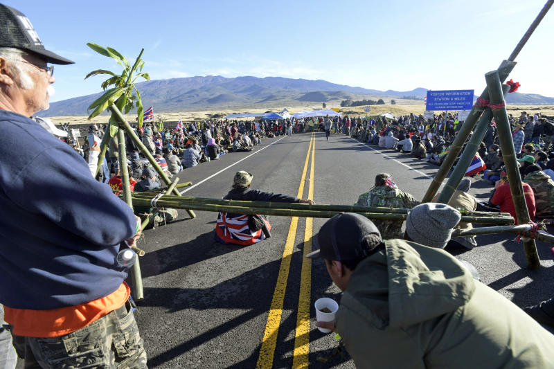 FILE: In this file photo from Friday, July 19, 2019, protesters continue their opposition vigil against the construction of the Thirty Meter Telescope at Mauna Kea on the Big Island of Hawaii Hawaii officials are demobilizing law enforcement at a mountain where protesters are blocking construction of a giant telescope because the project isn't moving forward for now. An international consortium wants to build the Thirty Meter Telescope on Mauna Kea, Hawaii's tallest peak. But some Native Hawaiians believe the telescope will desecrate sacred land. Protesters have stopped construction from going forward since mid-July. (Bruce Asato/Honolulu Star-Advertiser via AP)